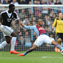 Aston Villa's Fabian Delph. right, stretches for the ball by Southampton's Victor Wanyama during the English Premier League soccer match between Aston Villa and Southampton at Villa Park, in Birmingham, England, Saturday, April 19, 2014