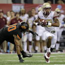Oklahoma State linebacker Seth Jacobs (10) is unable to reach Florida State wide receiver Rashad Greene (80) after a reception in the second half of an NCAA college football game, Saturday, Aug. 30, 2014, in Arlington, Texas The Associated Press