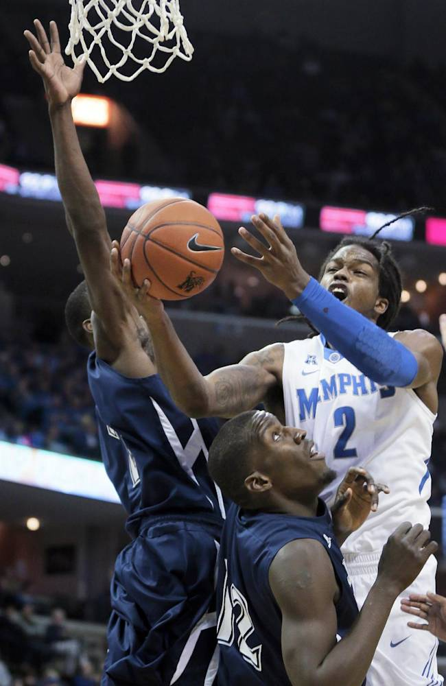 Memphis forward Shaq Goodwin (2) goes to the basket in front as Jackson State's Brandon West (12) and Derell Taylor, left, defend during the first half of an NCAA college basketball game in Memphis, Tenn., Saturday, Dec. 28, 2013