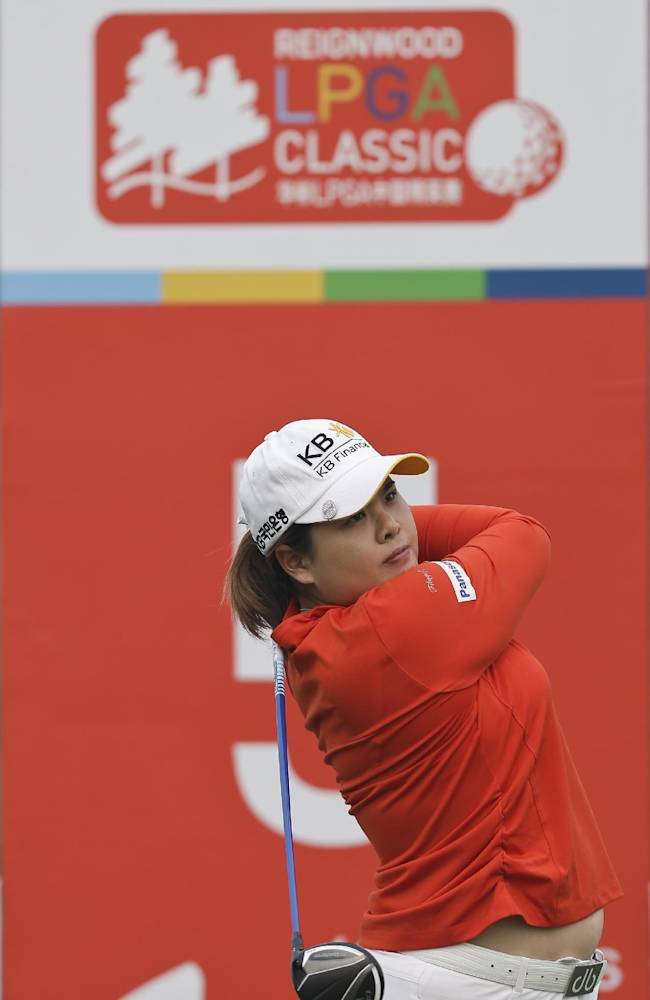 South Korea's Inbee Park tees off on the fifth hole during the third round of the Reignwood LPGA Classic golf tournament at Pine Valley Golf Club on the outskirts of Beijing, China, Saturday, Oct. 5, 2013