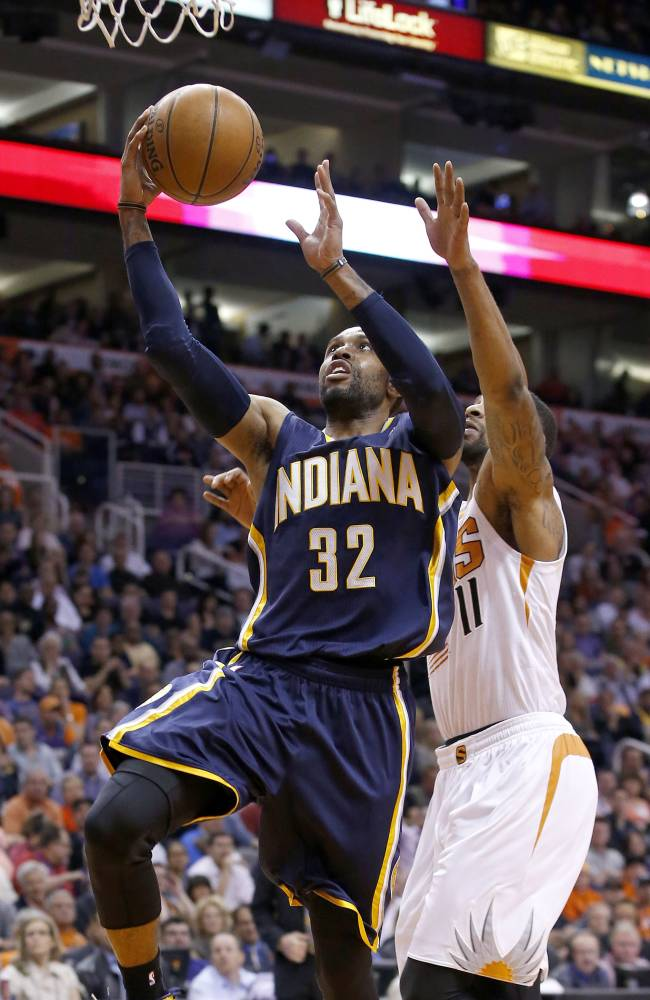 Indiana Pacers' C.J. Watson (32) scores as he gets past Phoenix Suns' Markieff Morris (11) during the first half of an NBA basketball game Wednesday, Jan. 22, 2014, in Phoenix