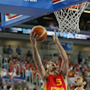 Spain's Rudy Fernandez, left, leaps for a basket past Serbia's Nenad Krstic during their EuroBasket European Basketball Championship quarterfinal match in Ljubljana, Slovenia, Wednesday, Sept. 18, 2013. (AP Photo/Petr David Josek)