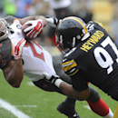In this Sept. 28, 2014, file photo, Pittsburgh Steelers defensive end Cameron Heyward (97) hits Tampa Bay Buccaneers running back Doug Martin (22) in the first quarter of the NFL football game in Pittsburgh. Heyward has become the de facto spokesman for a