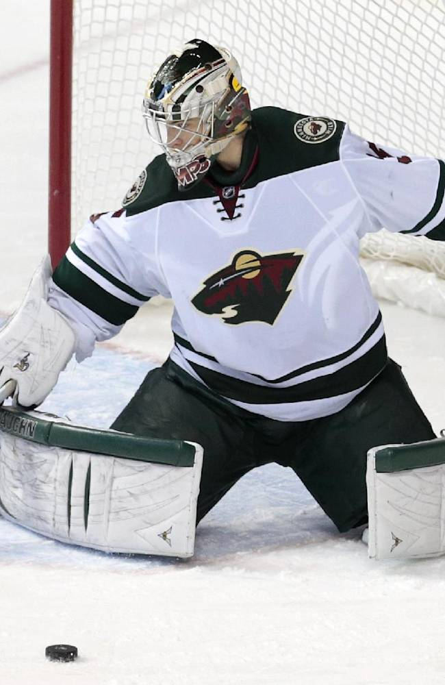 Minnesota Wild goalie Darcy Kuemper blocks a shot against the Nashville Predators in the third period of an NHL hockey game, Sunday, Jan. 12, 2014, in Nashville, Tenn. Kuemper stopped 23 shots as the Wild won 4-0