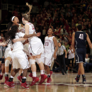 Stanford players celebrate after a 88-86 overtime win over Connecticut during an NCAA college basketball game on Monday, Nov. 17, 2014, in Stanford, Calif. (AP Photo/Marcio Jose Sanchez)