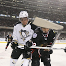 Pittsburgh Penguins left wing James Neal (18) and Chicago Blackhawks defenseman Michal Rozsival (32) vie for the puck during the first period of an NHL Stadium Series hockey game at Soldier Field on Saturday, March 1, 2014, in Chicago The Associated Press