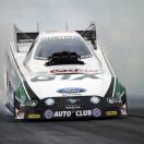 In this photo provided by NHRA, John Force gets ready for a qualifying run in Funny Car in at the NHRA Kansas Nationals drag races, Saturday, May 18, 2013, in Topeka, Kan. His performance of 4.043 seconds at 313.22 mph earned him the track record and No. 1 qualifying spot at Heartland Park Topeka. (AP Photo/NHRA, Marc Gewertz)
