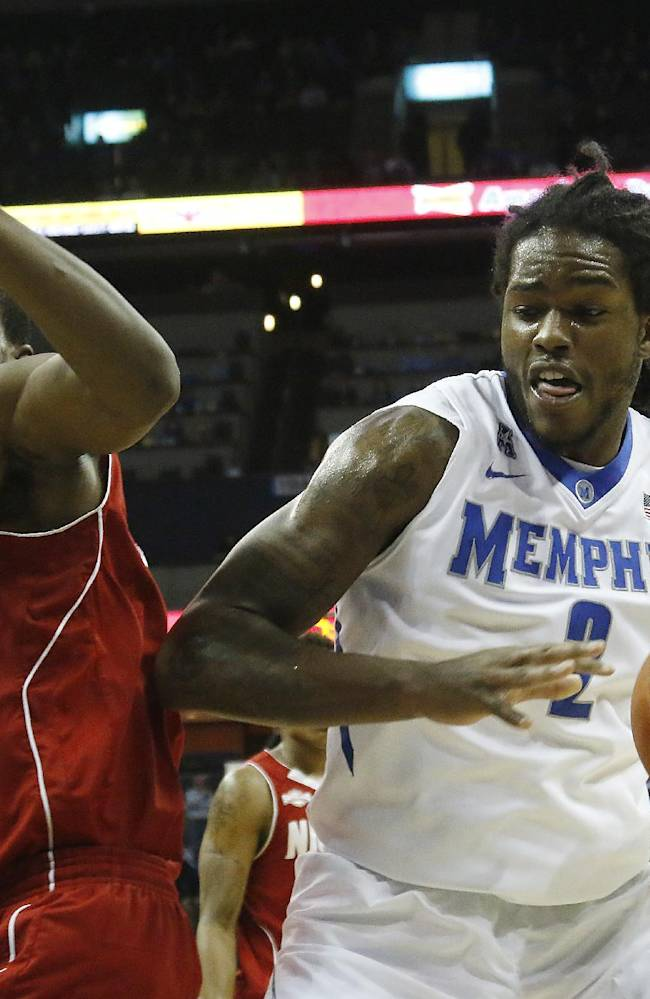 Memphis forward Shaq Goodwin (2) goes to the basket against Nicholls guard Jeremy Smith, left, in the second half of an NCAA college basketball game on Saturday, Nov. 23, 2013, in Memphis, Tenn. Memphis won 98-59