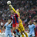 Bayern's Mario Goetze, left, and Manchester City's goalkeeper Joe Hart challenge for the ball during the Champions League Group E soccer match between FC Bayern Munich and Manchester City at Allianz Arena in Munich, southern Germany, Wednesday Sept. 17, 2
