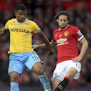 Crystal Palace's Fraizer Campbell, left, and Manchester United's Daley Blind battle for the ball during their English Premier League match at Old Trafford, Manchester England Saturday Nov. 8, 2014