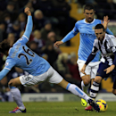 West Bromwich Albion's Morgan Amalfitano, right, is challenged by Manchester City's Martin Demichelis, left, and Aleksandar Kolarov during the English Premier League soccer match at The Hawthorns, West Bromwich, England, Wednesday Dec. 4, 2013. Manchester