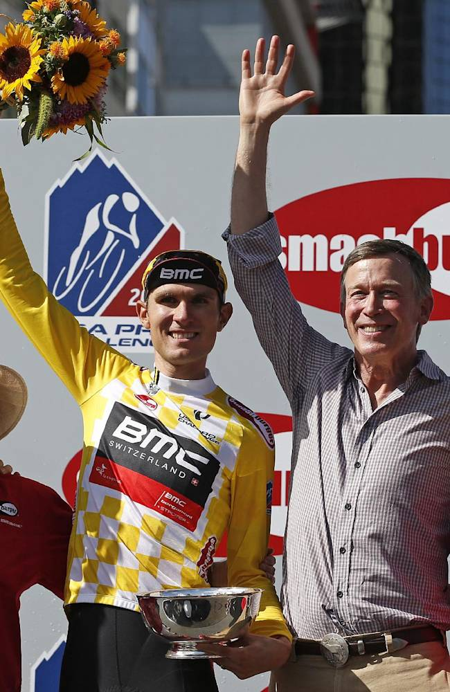 Tejay van Garderen, left,  of BMC Racing Team,stands with by Colo. Gov. John Hickenlooper atop the winner's podium after van Garderen won the 2014 USA Pro Challenge bike race, in Denver, Sunday, Aug. 24, 2014. The seven-day race took riders from around the world through the Colorado mountains, finishing in Denver Sunday