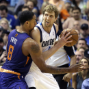 Dallas Mavericks forward Dirk Nowitzki, right, of Germany, get close defense from Phoenix Suns forward Channing Frye (8) during the first half of an NBA basketball game on Saturday, April 12, 2014, in Dallas The Associated Press