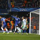 Chelsea's Demba Ba, centre, celebrates the opening goal during the Champions League Group E soccer match between Chelsea and Steaua Bucharest at Stamford Bridge Stadium in London Wednesday, Dec. 11, 2013