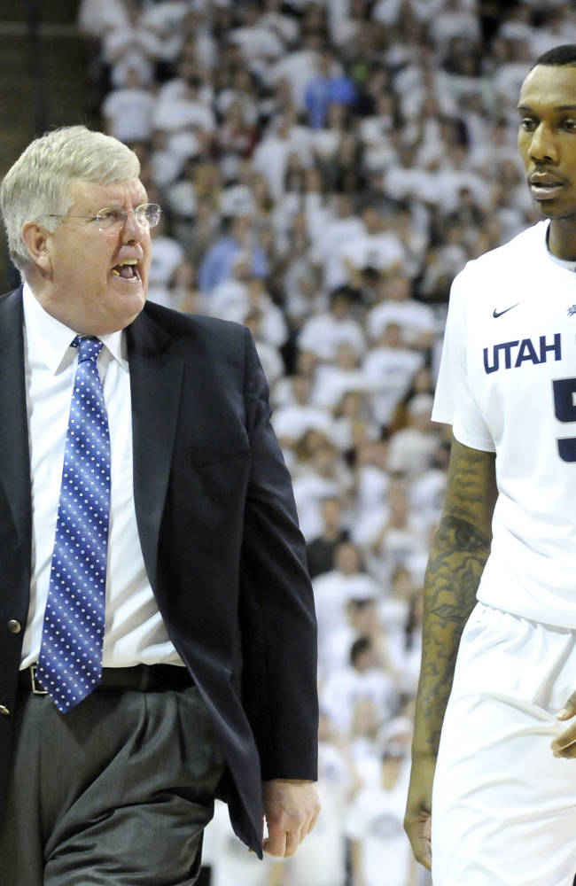 Utah State head coach Stew Morrill yells at Utah State center Jarred Shaw (5) after picked up his fifth foul in the second half of an NCAA college basketball game Saturday, Jan. 25, 2014, in Logan, Utah