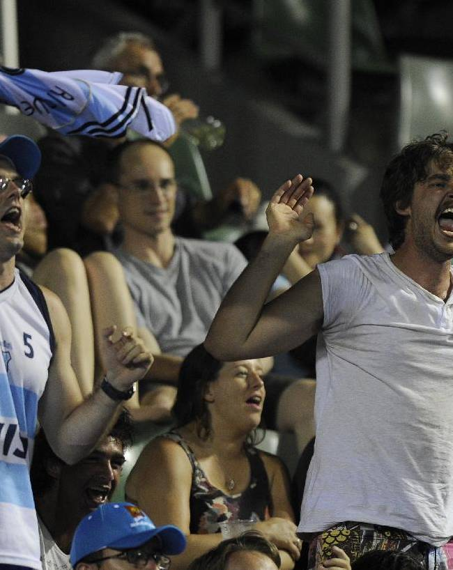 Supporters of Juan Martin del Potro of Argentina cheer him on during his second round match against Roberto Bautista Agut of Spain at the Australian Open tennis championship in Melbourne, Australia, Thursday, Jan. 16, 2014