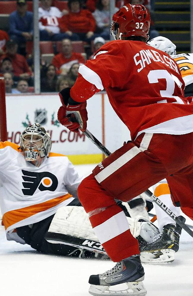 Philadelphia Flyers goalie Steve Mason (35) stops a Detroit Red Wings shot in the second period of an NHL hockey game in Detroit, Wednesday, Dec. 4, 2013
