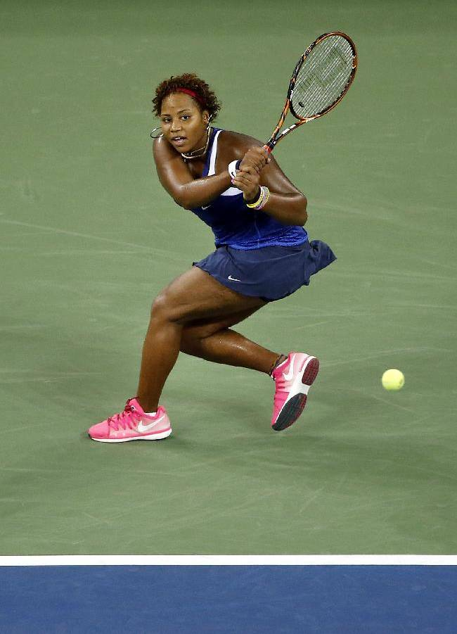 Taylor Townsend, of the United States, returns a shot to Serena Williams during the opening round of the U.S. Open tennis tournament Tuesday, Aug. 26, 2014, in New York