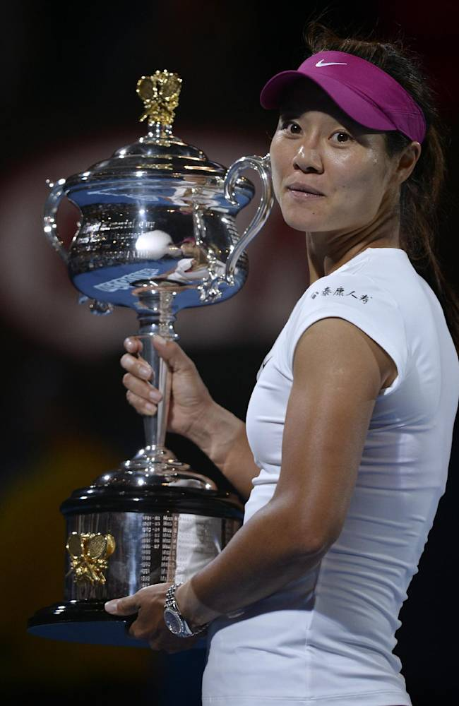 Li Na of China holds the trophy after defeating Dominika Cibulkova of Slovakia in their women's singles final at the Australian Open tennis championship in Melbourne, Australia, Saturday, Jan. 25, 2014