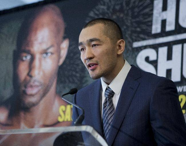 WBA and IBA Light Heavyweight Champion Beibut Shumenov of Kazakhstan, speaks during a news conference in Washington, Tuesday, March 11, 2014, announcing his Light Heavyweight World Championship unification bout against IBF Light Heavyweight World Champion Bernard Hopkins, background, to be held at the DC Armory in Washington on April 19, 2014