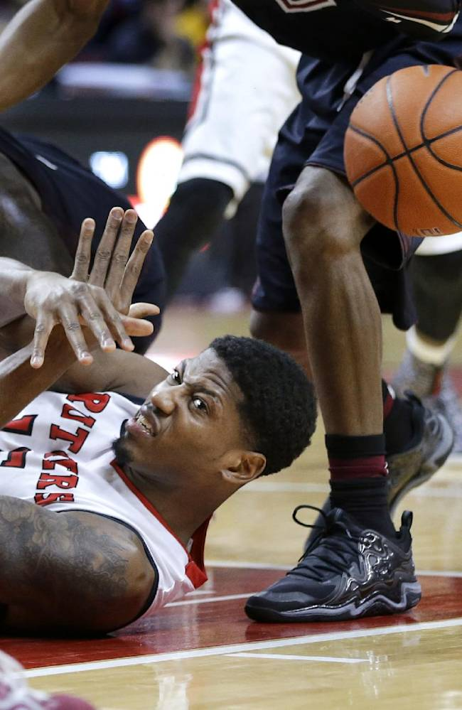 Rutgers guard Craig Brown (15) makes a pass from the floor during the second half of an NCAA college basketball game against Temple in Piscataway, N.J., Wednesday, Jan. 1, 2014. Rutgers won 71-66