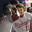 Washington Nationals' Roger Bemadina (2) celebrates with Ryan Zimmeran (11) after Zimmerman hit a third-inning-two-run home run against the Miami Marlins in a baseball game in Miami, Friday, July 13, 2012. (AP Photo/J Pat Carter)