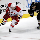 Carolina Hurricanes defenseman Andrej Sekera (4), of the Czech Republic controls the puck against Anaheim Ducks right wing Daniel Winnik (34) during the second period of an NHL hockey game, Sunday, March 2, 2014, in Anaheim, Calif The Associated Press