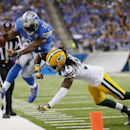 Detroit Lions running back Reggie Bush (21) is pushed out of bounds by Green Bay Packers cornerback Davon House (31) during the first half of an NFL football game in Detroit, Sunday, Sept. 21, 2014 The Associated Press