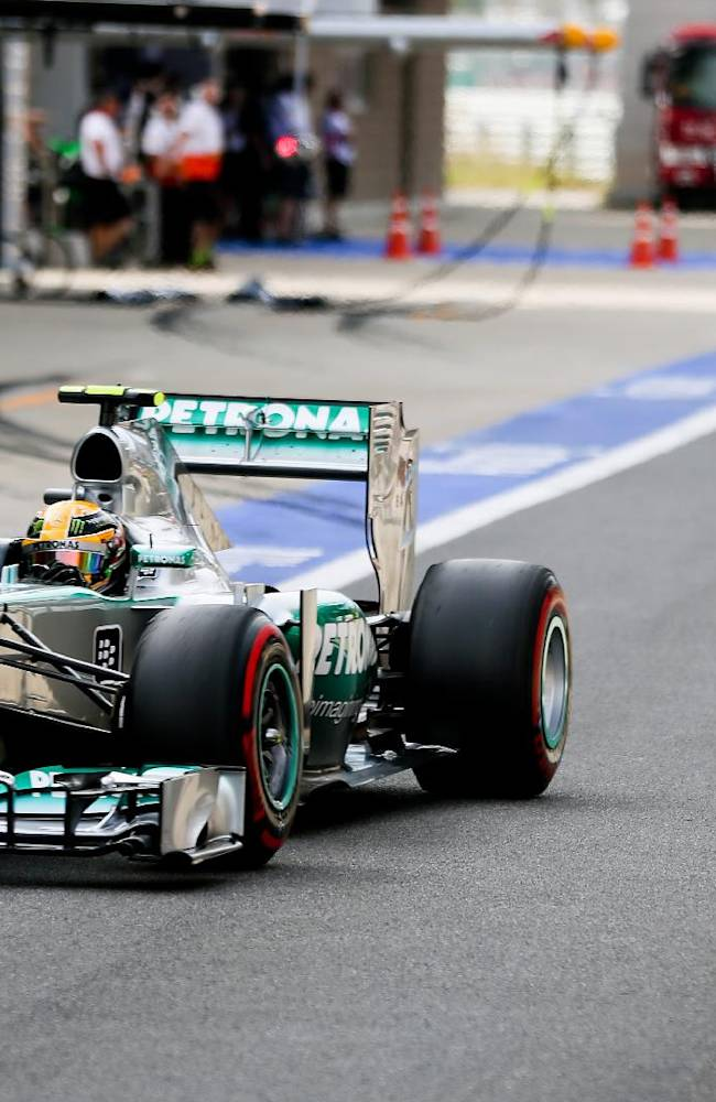 Mercedes driver Lewis Hamilton of Britain steers his car into his pit lane during qualifying at the Korean Formula One Grand Prix at the Korean International Circuit in Yeongam, South Korea, Saturday, Oct. 5, 2013