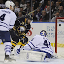 Buffalo Sabres left winger Ville Leino (23) shoots the puck off the goalpost as Toronto Maple Leafs defenseman Cody Franson (4) and goaltender Jonathan Bernier (45) defend during the first period of an NHL hockey game in Buffalo, N.Y., Friday, Nov. 15, 20