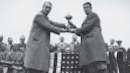<p>Samuel Ryder poses with winning Captain George Duncan following the 1929 Ryder Cup matches.(PGA of America/Getty Images)</p>