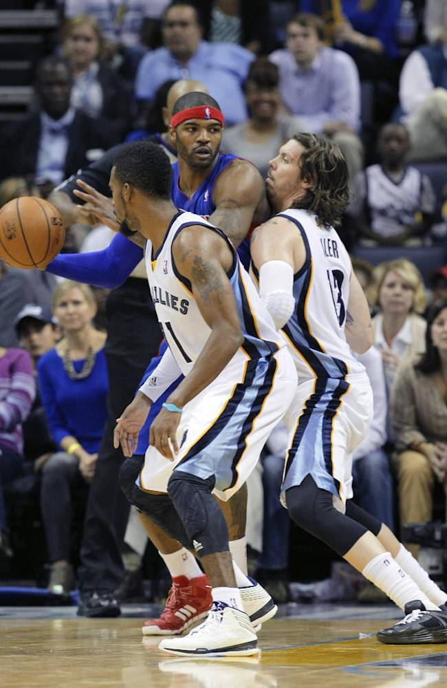 Memphis Grizzlies' Mike Miller, right, and Mike Conley, left, defend Detroit Pistons' Josh Smith during the second half of an NBA basketball game in Memphis, Tenn., Friday, Nov. 1, 2013. The Grizzlies defeated the Pistons 111-108 in overtime