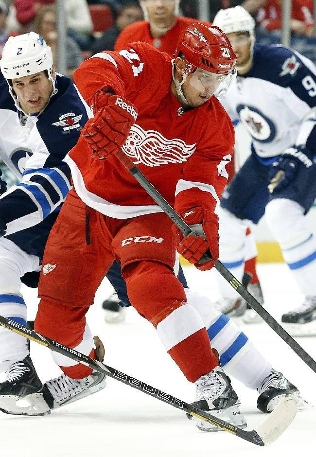 Winnipeg Jets defenseman Adam Pardy (2) defends against Detroit Red Wings' Tomas Tatar (21), of the Czech Republic, during the second period of an NHL hockey game in Detroit, Tuesday, Nov. 12, 2013
