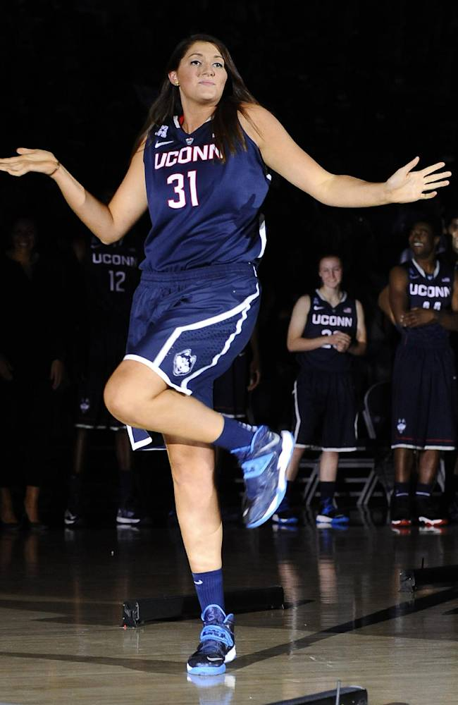 Connecticut's Stefanie Dolson dances as she is introduced at the men's and women's basketball teams' First Night event Friday, Oct. 18, 2013, in Storrs, Conn
