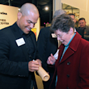 Former Texas Rangers catcher Ivan Rodriguez autographs a bat for a fan before being inducted into the Texas Sports Hall Of Fame, Thursday, Feb. 27, 2014, in Waco, Texas The Associated Press