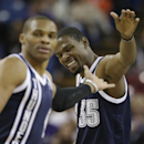 Oklahoma City Thunder forward Kevin Durant, right, slaps hands with teammate Russell Westbrook after scoring in the first quarter of an NBA basketball game against the Sacramento Kings in Sacramento, Calif., Tuesday, Dec. 3, 2013. The Thunder won 97-95 T