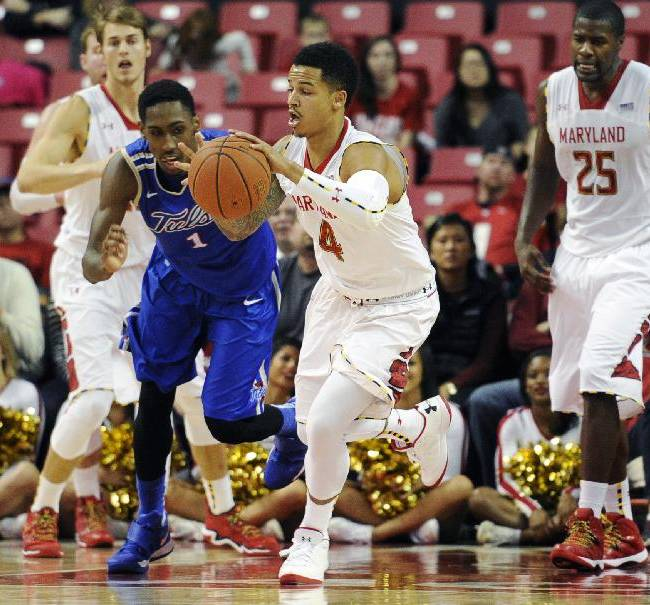 Maryland guard Seth Allen (4) dribbles the ball against Tulsa forward Rashad Smith (1) during the second half of an NCAA college basketball game, Sunday, Dec. 29, 2013, in College Park, Md. Maryland won 85-74