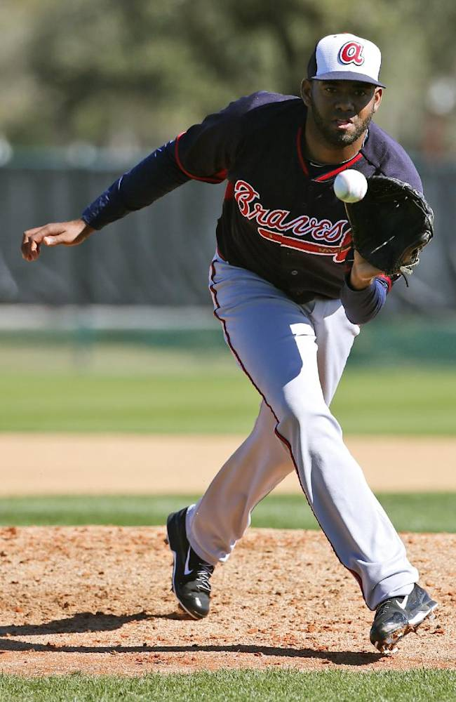 Atlanta Braves pitcher Lay Batista fields a ball during a spring training baseball workout, Tuesday, Feb. 18, 2014, in Kissimmee, Fla