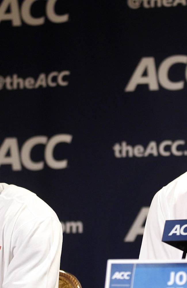 Virginia Tech basketball players Ben Emelogu, left, and Joey van Zegeren answer questions at a press conference during the NCAA college Atlantic Coast Conference media day in Charlotte, N.C., Wednesday, Oct. 16, 2013