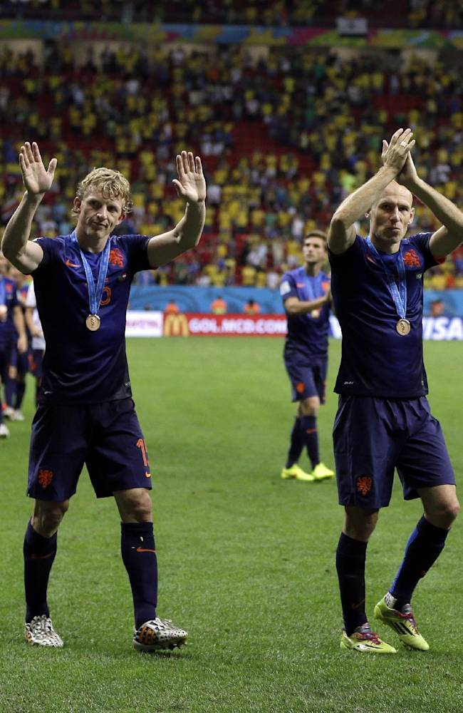 Netherlands' Dirk Kuyt, left, and Arjen Robben applaud their supporters after their 3-0 victory over Brazil during the World Cup third-place soccer match between Brazil and the Netherlands at the Estadio Nacional in Brasilia, Brazil, Saturday, July 12, 2014
