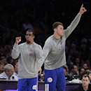 Los Angeles Clippers' Chris Paul, left, and Blake Griffin react to a basket made by the Clippers during the first half of an NBA basketball game against the Los Angeles Lakers on Thursday, March 6, 2014, in Los Angeles The Associated Press