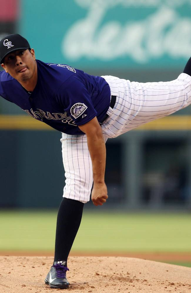 Colorado Rockies starting pitcher Jorge De La Rosa works against the San Francisco Giants in the first inning of a baseball game in Denver on Monday, April 21, 2014