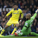 Chelsea's Diego Costa, left, is thwarted by Everton's goalkeeper Tim Howard during their English Premier League soccer match at Goodison Park Stadium, Liverpool, England, Saturday Aug. 30, 2014