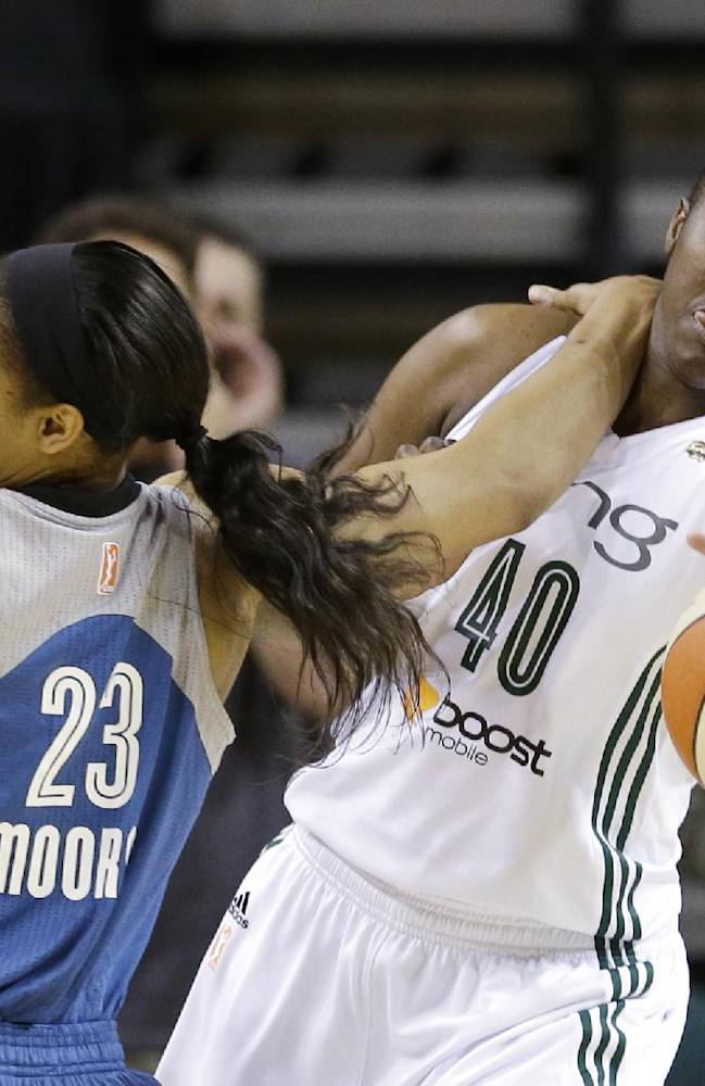 Seattle Storm's Shekinna Stricklen (40) and Minnesota Lynx's Maya Moore tangle as they chase a loose ball in the first half of a WNBA basketball game Tuesday, Sept. 10, 2013, in Seattle