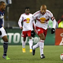 Thierry Henry (14) carries the ball past Teal Bunbury (10) during the second half of the Eastern Conference Championship at Gillette Stadium. Nov 29, 2014;Winslow Townson-USA TODAY Sports