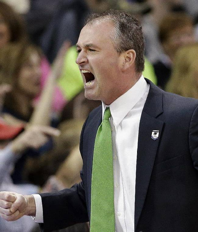 In this March 22, 2014 file photo, North Dakota State head coach Saul Phillips reacts to a basket during NDSU's 63-44 loss to San Diego State in a third round game of the NCAA men's college basketball tournament in Spokane, Wash. Phillips is among 15 finalists for the 2014 Hugh Durham Award. The winner will be announced at the CollegeInsider.com Awards Banquet on April 4 in Dallas, site of this year's Final Four