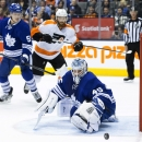 Toronto Maple Leafs goaltender Jonathan Bernier (45) makes a save against the Philadelphia Flyers during the third period of an NHL hockey game, Saturday, March 8, 2014 in Toronto The Associated Press