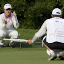 CORRECTS LAST NAME TO KO, NOT KOM - Lydia Ko, of New Zealand, discuss the shot with her caddie during the first round of the Canadian Women's Open golf tournament in Edmonton Alberta, Thursday, Aug. 22, 2013. (AP Photo/The Canadian Press, Jason Franson)