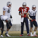 New England Patriots tight end Rob Gronkowski (87), quarterback Tom Brady (12) and wide receiver Julian Edelman (11) warm up during practice Wednesday, Jan. 28, 2015, in Tempe, Ariz. The Patriots play the Seattle Seahawks in NFL football Super Bowl XLIX S