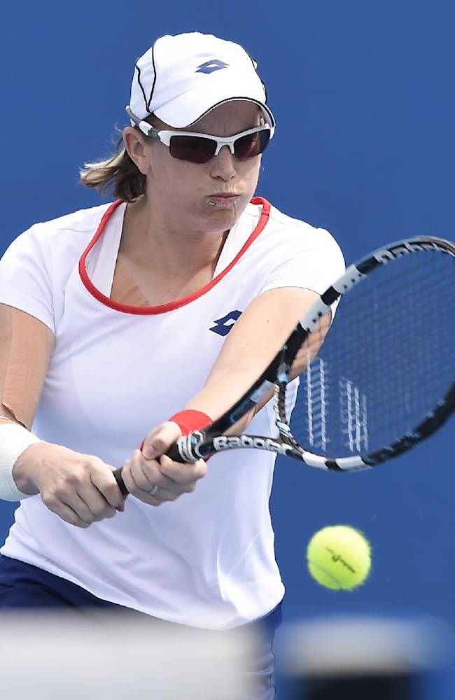 Romina Oprandi of Switzerland makes a backhand return to Denisa Allertova of the Czech Republic during their first round match at the Australian Open tennis championship in Melbourne, Australia, Tuesday, Jan. 20, 2015